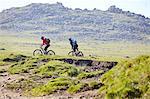 Cyclists cycling on hillside