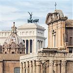 Compressed perspective of Roman lendmarks. Ruins of the Roman Forum, Basilica di Santa Maria in Ara coeli, Mamertine Prison, Curia Iulia and Terrazza delle Quadrighe in Rome, Italy.