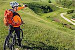 Cyclist in orange jersey on the Beautiful Meadow Trail