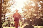 Male hiker walking in forest