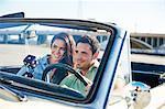 Couple in convertible car, Los Angeles, California, USA