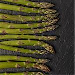 Fresh Asparagus spears on slate