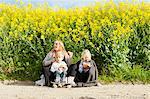 Family having snacks at oilseed rape field
