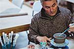 Male potter working at workshop