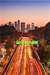 Los Angeles, California, USA skyline and highway.