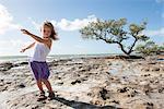 Girl dancing on beach in the Florida Keys, Florida, USA