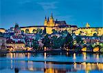 Czech Republic, Prague, Stare Mesto (Old Town). Prague Castle, Prazsky Hrad, on the Vltava River at dusk.