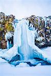 Snaefellsness peninsula, Western Iceland, Europe. Frozen Kirkjufellfoss waterfall in winter.