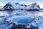 Stokksnes, Eastern Iceland, Europe. Vestrahorn mountain in a frozen winter landscape.