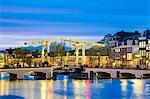 Netherlands, North Holland, Amsterdam. Magere Brug, Skinny Bridge, on the Amstel River at night.