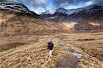 Scotland, Highland, Glencoe. Hiker in Glencoe area in the winter.MR.