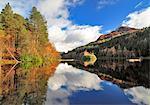Scotland, Glencoe. Reflections of autumn trees and the Pap of Glencoe.