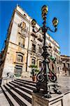 Steps and lamp post at Piazza Pretoria (Pretoria Square) at historic center of Palermo in Sicily, Italy