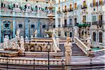 Assortment of statues and stonework at the Pretoria Fountain in Piazza Pretoria (Pretoria Square) in historic center of Palermo in Sicily, Italy