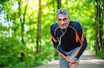 Senior male runner on his mark in forest park