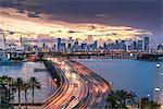 Miami skyline at dusk, traffic on MacArthur causeway, Florida, USA
