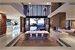 Modern luxury home showcase interior with sunset ocean view