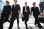 Young Japanese businessmen walking