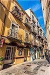 Shops along Narrow Street in Cefalu, Sicily, Italy