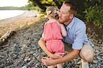 Mid adult man hugging daughter at Lake Ontario, Oshawa, Canada