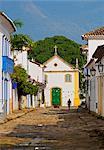 Brazil, State of Rio de Janeiro, Paraty, View of Rua Samuel da Costa and Nossa Senhora do Rosario e Sao Benedito Church.
