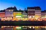 Denmark, Hillerod, Copenhagen. Colourful buildings along the 17th century waterfront of Nyhavn at dusk.