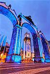 Portugal, Azores, Sao Miguel, Ponta Delgada, Twilight view of Main Church Igreja Martiz through Town Gates Portas da Cidade.