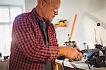 Attentive goldsmith working in workshop