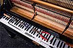 Close-up of repairing tools kept on old piano keyboard