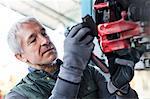 Close up focused mechanic replacing brake pads in auto repair shop