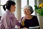 Elderly woman speaking with her doctor.