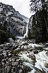 View of lower Yosemite waterfall among mountains, Yosemite National Park, California, USA