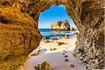 Framed View through Natural Arch at Praia de Sao Rafael, Albufeira, Algarve, Portugal