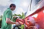 Man charging electric car