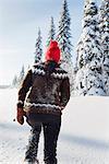 Woman walking through snow