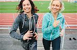 Women running on stadium