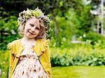 Smiling girl wearing midsummer wreath