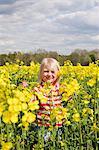 Girl on oilseed rape field