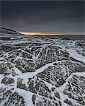 Rocky coastline at dusk