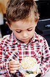 Boy eating ice-cream, Stockholm, Sweden