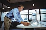 Businessman using digital tablet and desktop pc in office