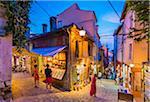 People at Shops in Alleyway at Dusk in Rovinj, Istria, Croatia