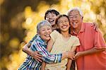 Portrait of smiling senior couple with their grandchildren.