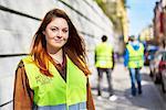 Sweden, Uppland, Stockholm, Kungsholmen, Volunteers on sidewalk