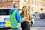 Sweden, Uppland, Stockholm, Kungsholmen, Volunteers on street