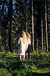 Finland, Paijat-Hame, Heinola, Two girls (2-3, 4-5) standing in spruce forest