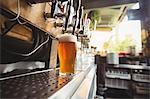 Close-up of beer pump in a row at bar