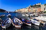 Portovenere (Porto Venere), UNESCO World Heritage Site, colourful harbourfront houses, boats and castle, Ligurian Riviera, Liguria, Italy, Europe