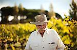 Senior man standing in his vineyard
