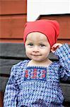 Baby girl sitting on bench